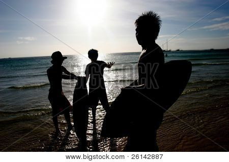 boarders silhouettes at sunset