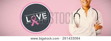 Breast cancer awareness message on poster against smiling nurse wearing breast cancer awareness ribbon