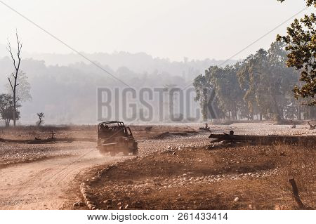Open-top Car On The Field Road. Competition Off Road And Rough Terrain. The Safari Vehicles On The B