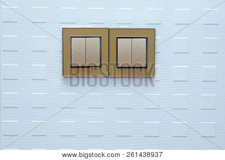 Light Switch On The Wall . Light Switch, Turn On Or Turn Off The Lights . A Light Switch, A Plastic