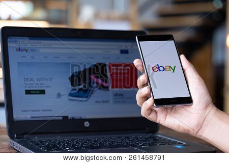 Chiang Mai, Thailand - Sep. 08,2018: Man Hands Holding Huawei With Ebay Apps On The Screen. Ebay Is
