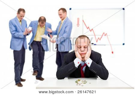A manager having just sent his employees notice of the bankruptcy of their company, having to lay off his staff.