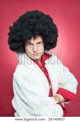 Arrogantly looking man, wearing a wig and a fur coat.