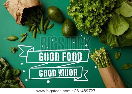 Top View Of Different Green Ripe Vegetables On Green Surface With Good Food - Good Mood Inspiration
