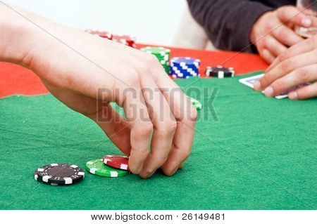 A poker player raising the bet on his game