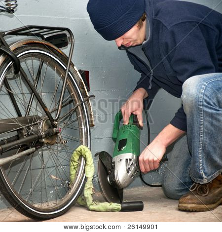 Criminal grinding through the lock of a stolen bicycle