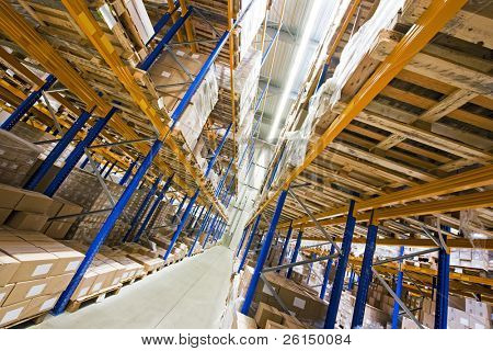 Shelves, full of boxes in a huge warehouse, ready for transport to the customer