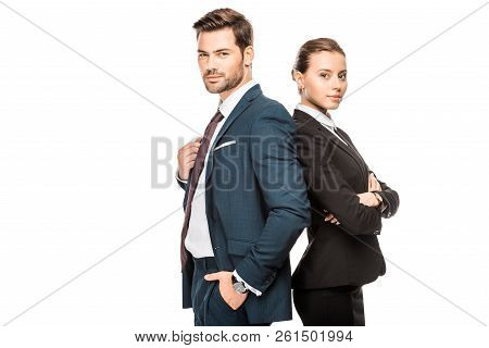 Confident Young Business Partners Leaning Back To Back And Looking At Camera Isolated On White