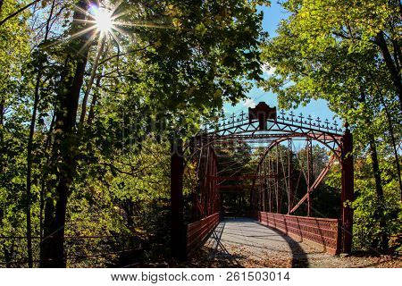 NEW MILFORD, CT, USA - OCTOBER 17, 2014:  Metal Falls Bridge completed 1895 located in Lover`s Leap State Park on October 17, 2014 in New Milford.