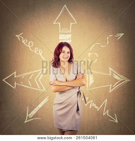 Redhead Woman Standing With Arms Crossed And Arrows Pointed To Different Directions Over Colorful Ba