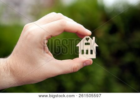 Hand Holds The House Figure Housing Concept