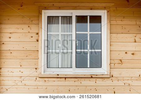 Plastic Pvc Window In New Modern Passive Wooden House Facade Wall. Pvc Windows Are The Number One In