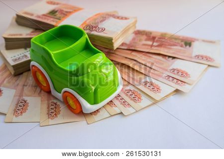Car Loan.concept Of Savings To Buy A Car Money.miniature Car Model Near Cash Money , Russian Rubles,