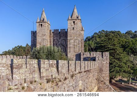 Santa Maria da Feira, Portugal - October 12, 2017: Keep of the Feira Castle seen from the walls, View of battlements, crenels, crenellation and merlons