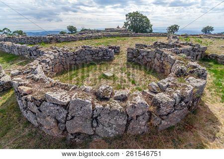 Pacos de Ferreira, Portugal - September 9, 2017: House ruins in Citania de Sanfins, a Celtic-Iberian prehistoric fortified Castro hillfort settlement