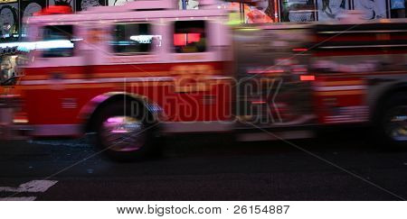 Fire truck screaming by