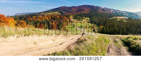 Panorama Of Mountainous Landscape In Autumn. Country Road Down The Hill. Parking Lot In The Valley.