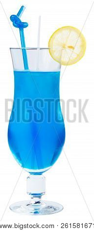 Blue Lagoon Alcohol Cocktail With Lemon And Ice In A Tall Glass. Side View Isolated On A White Backg