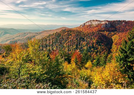 Beautiful Landscape In Mountains Of Romania. Cliff Above The Forest In Fall Color. Beautiful View In