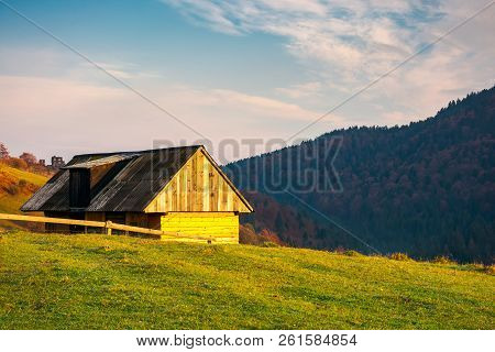 Wooden Barn In Village Outskirts On Hill In Morning Light. Beautiful Autumn Countryside