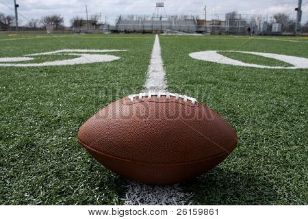 American football near the fifty