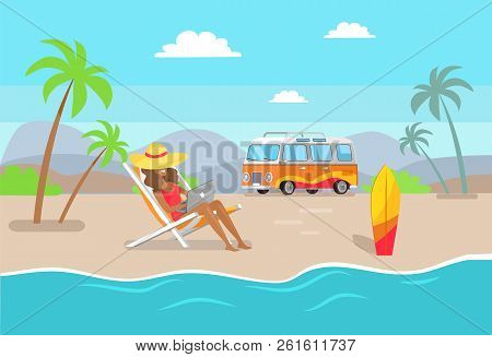 Woman In Straw Hat Working On Laptop At Sandy Beach. Suntanned Girl Works As Freelancer Summertime.