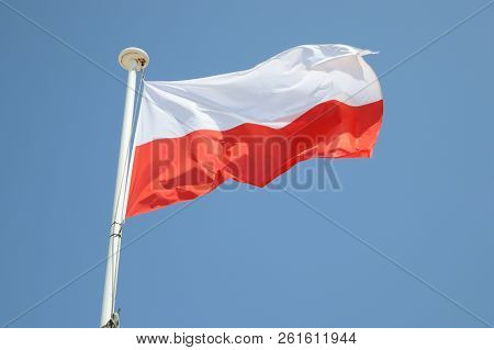 Poland Flag On A Mat In The Wind And Blue Sky