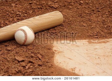 Baseball & Bat close up near home plate