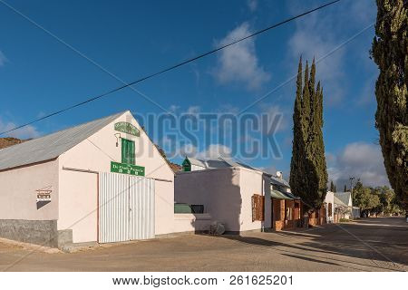 Victoria West, South Africa, August 7, 2018: A Street Scene, With The Oldest Building In Town And Ot