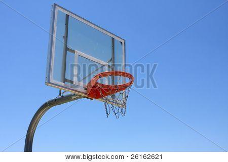 Outdoor Basketball Hoop against a blue sky