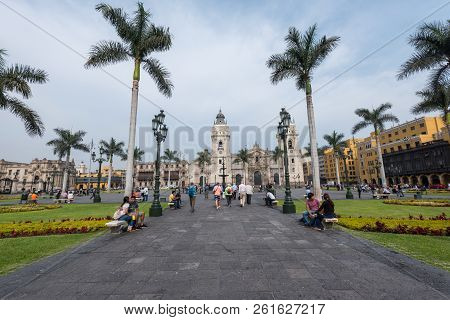 Lima, Peru--april 12, 2018. Tourists, Pedestrians And Residents In The Plaza Mayor, The Center Of Th