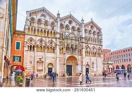 Ferrara, Italy - April 30, 2013: The Doumo Of Ferara Has The Most Beautiful Frontage Among Othe Chur