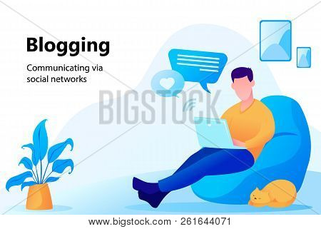 Concept Of Blogging. Man Sitting In Comfortable Armchair At Home And Working On Laptop. Communicatio