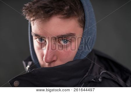 Portrait Of A Young Man With Hoodie