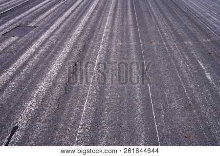 Close Up Of An Old Airstrip With Faded White Lines For Backgrounds