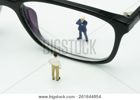 Miniature People Businessmen Standing Stand Looking Through Your Eyes, Black Frame. Reflections On F