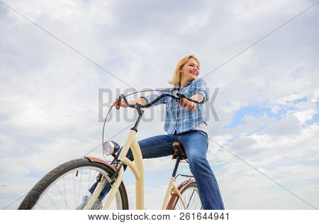 Girl Rides Bicycle Sky Background. Most Satisfying Form Of Self Transportation. Carefree And Satisfi
