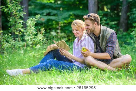 Romantic Date At Green Meadow. Couple In Love Spend Leisure Reading Book. Romantic Couple Students E