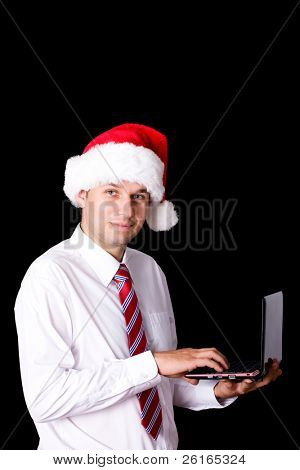 young santa in shirt and necktie use small netbook, christmas online shopping concept, studio shoot isolated on black