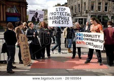 EDINBURGH, SCOTLAND, UK - SEPTEMBER 16: Small group of anti-Pope protesters with banners during Pope Benedict XVI parade on September 16, 2010 in Edinburgh, Scotland, United Kingdom.