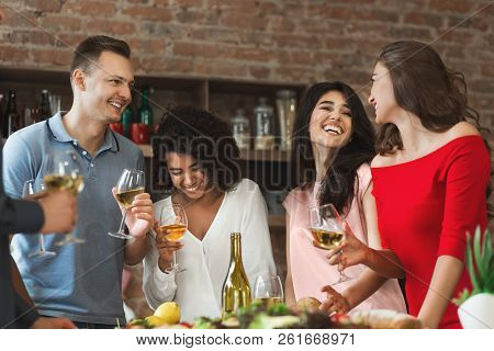 Happy Multiracial Friends Having Fun At Home Party