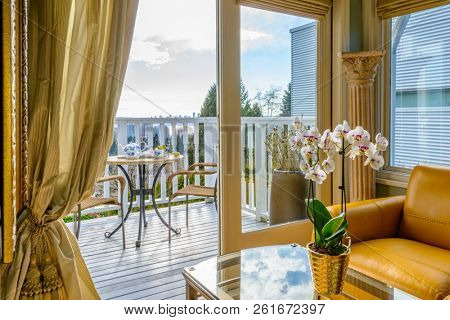 Fragment of interior design of a luxury boutique living room with balcony.