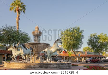 Scottsdale,Az/USA - 10.3.2018:   Bob Parks, donated this fountain in 1989,  The five champion Arabian horses complement the 5th Avenue shops and gallery old town area of Scottsdale.