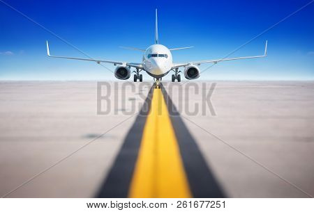 Modern Aircraft On A Runway Against A Blue Sky