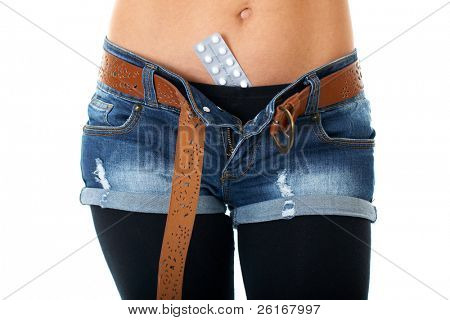 female belly with contraception pills, isolated on white background