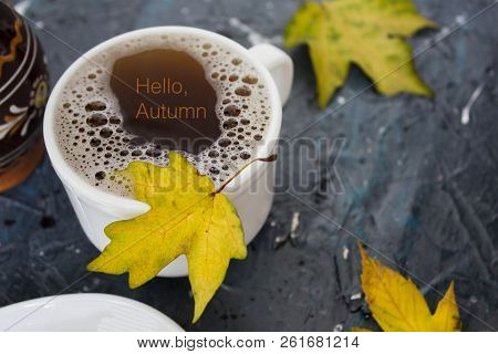 Autumn Still Life. Cup Of Tea With Maple Autumn Leaves And Inscription Hello Autumn On The White Bac