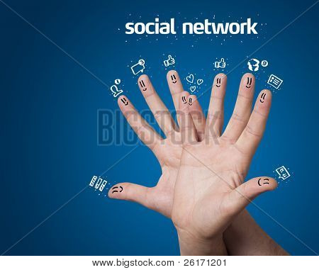 Happy group of finger smileys with social network sign and icons on blue background