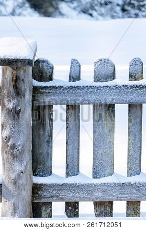 Specific Winter Season Image With A Snowy Wooden Fence, Surrounded By A Thick Layer Of Snow, On A Su