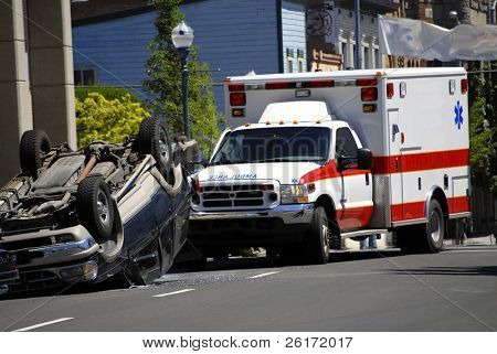 Car Wreck with Smashed Rolled Car and Ambulance