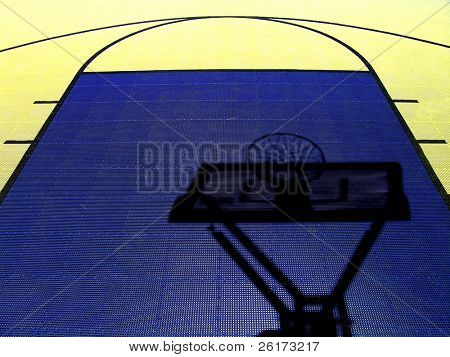 Shadow of a basketball hoop and net on a colorful basketball court